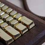 The keyboard features gold-plated zink key caps